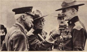 CG Morton showing Collier Gates medals to inspecting General