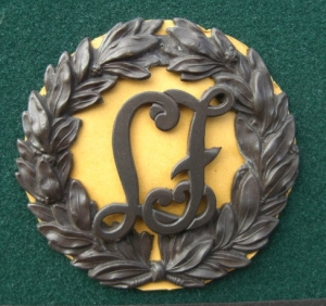 2 LF laurel wreath hat badges